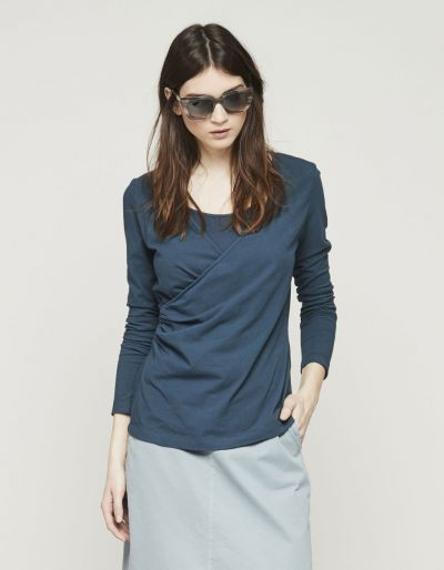 Top with a surplice neckline and long sleeves